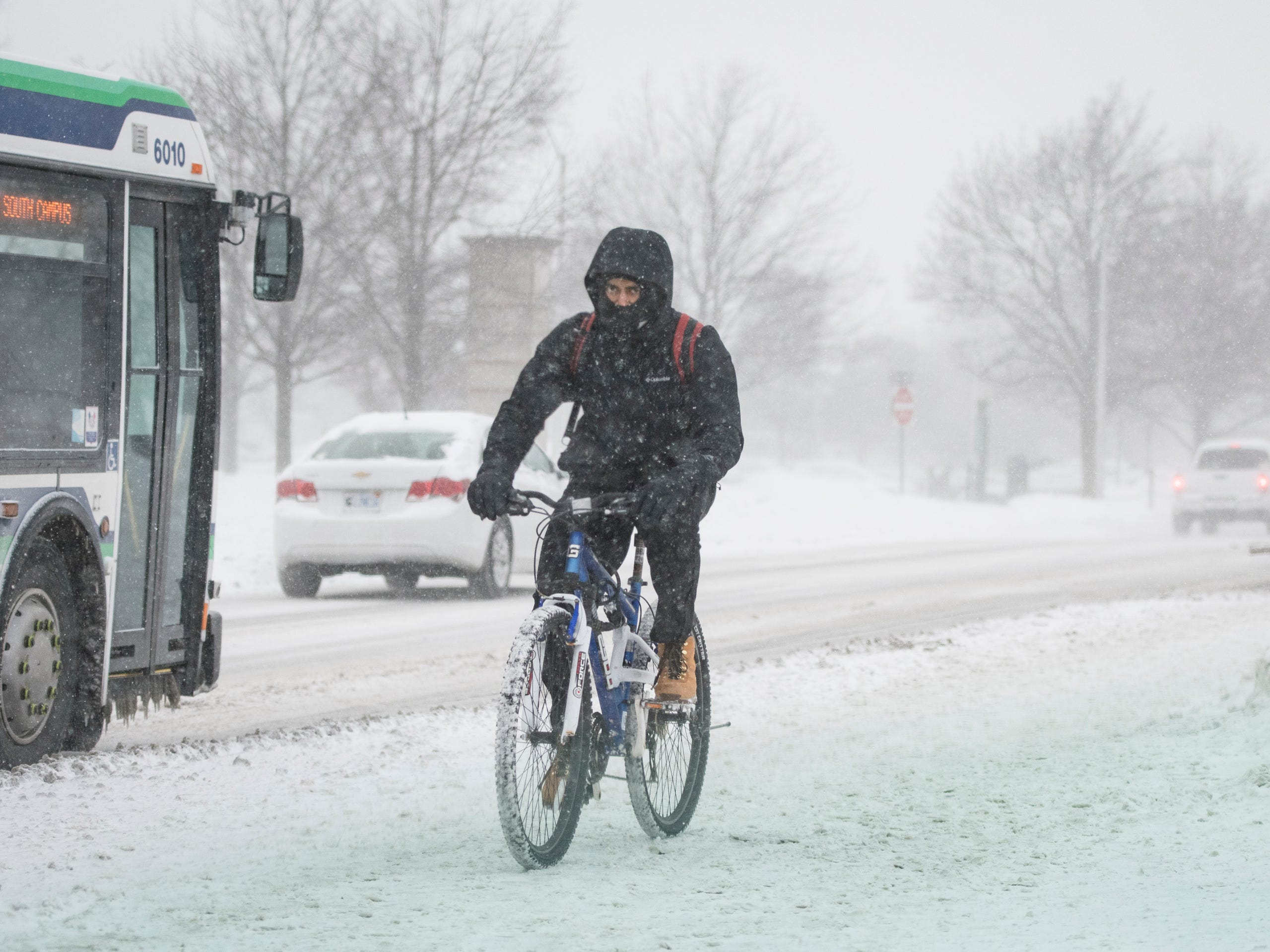 A bicyclist rides on the campus of Michigan State University, Jan. 29, 2019, in East Lansing.