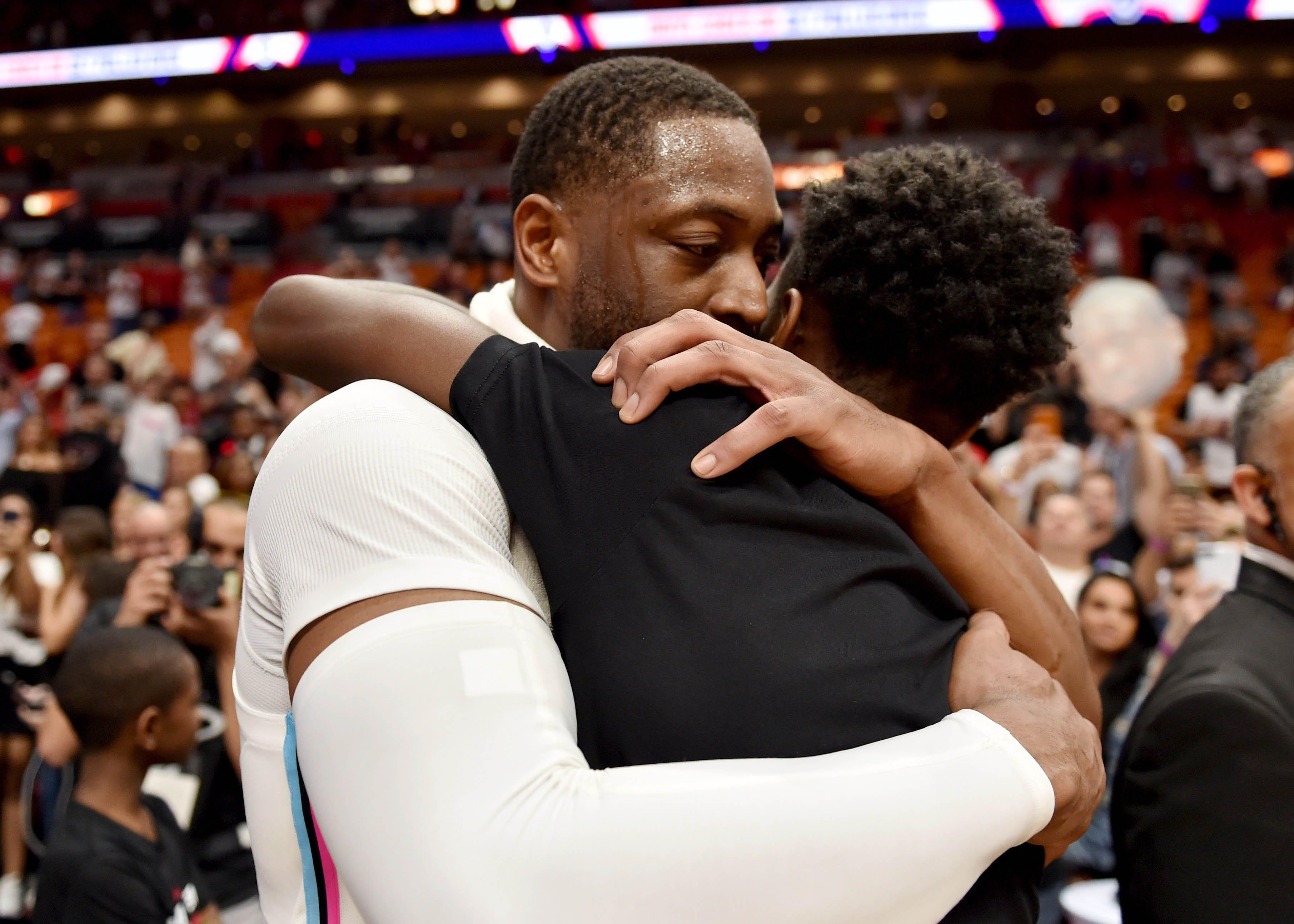 Feb 9, 2018: Dwyane Wade hugs his son Zaire.