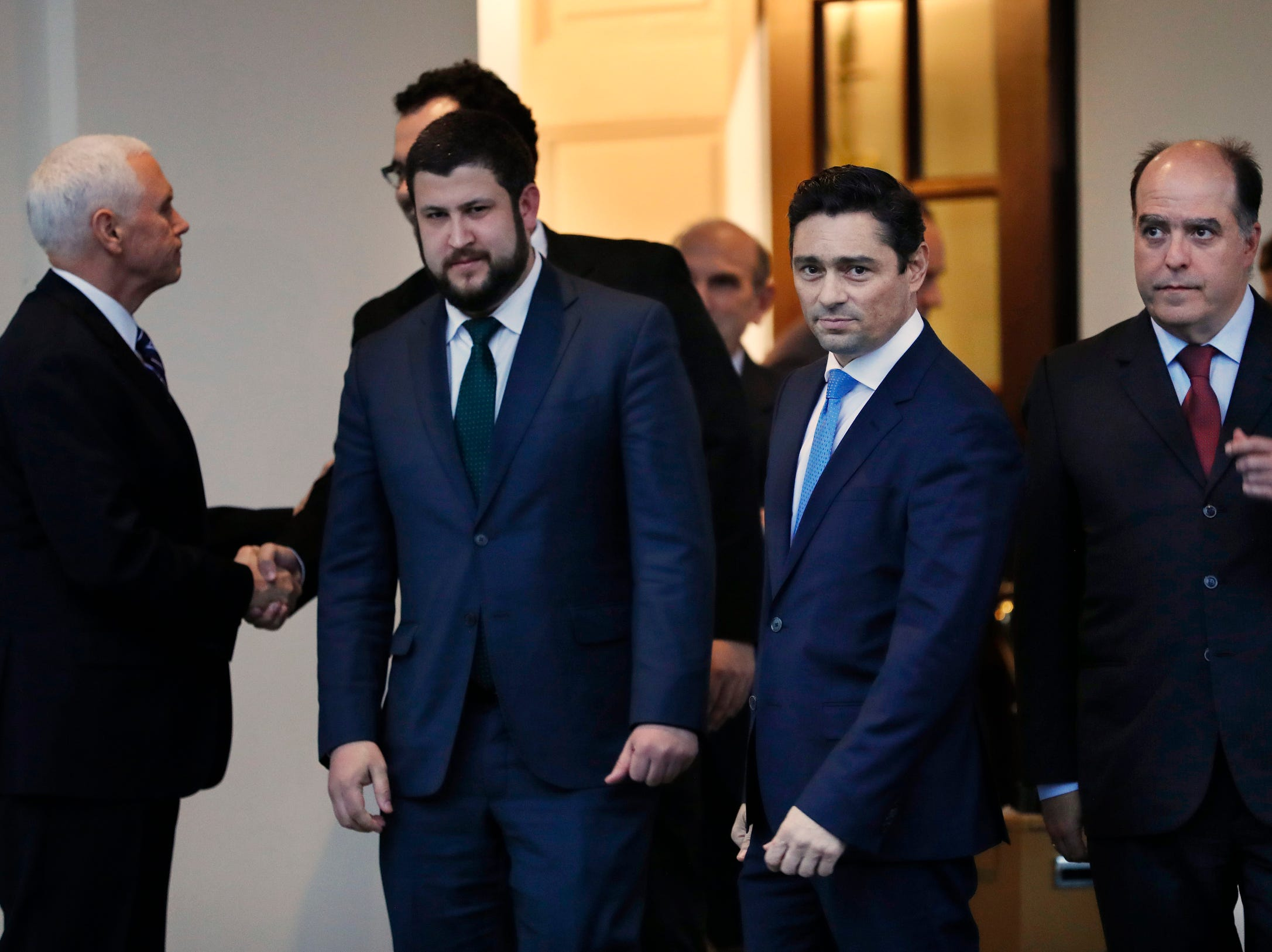 Vice President Mike Pence, left, shakes hands with Francisco Marquez, as Marquez and fellow Venezuelan opposition leaders David Smolansky, left, Carlos Vecchio, and Julio Borges, leave their meeting, Tuesday, at the White House in Washington, DC.