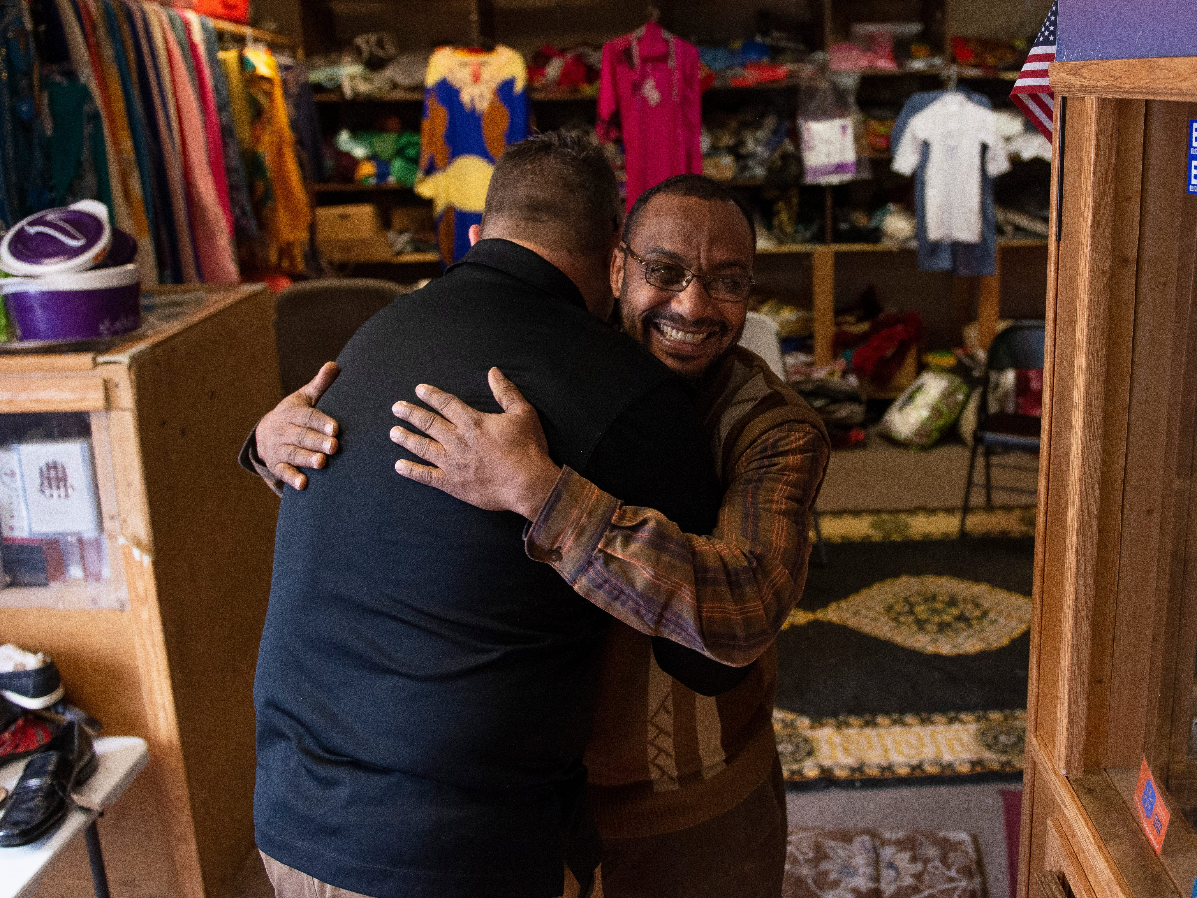 Kearny County Hospital CEO Benjamin Anderson, left, and African Shop employee Adam Keynan hug as Anderson shops for groceries at the store Thursday, Jan. 24, 2019.