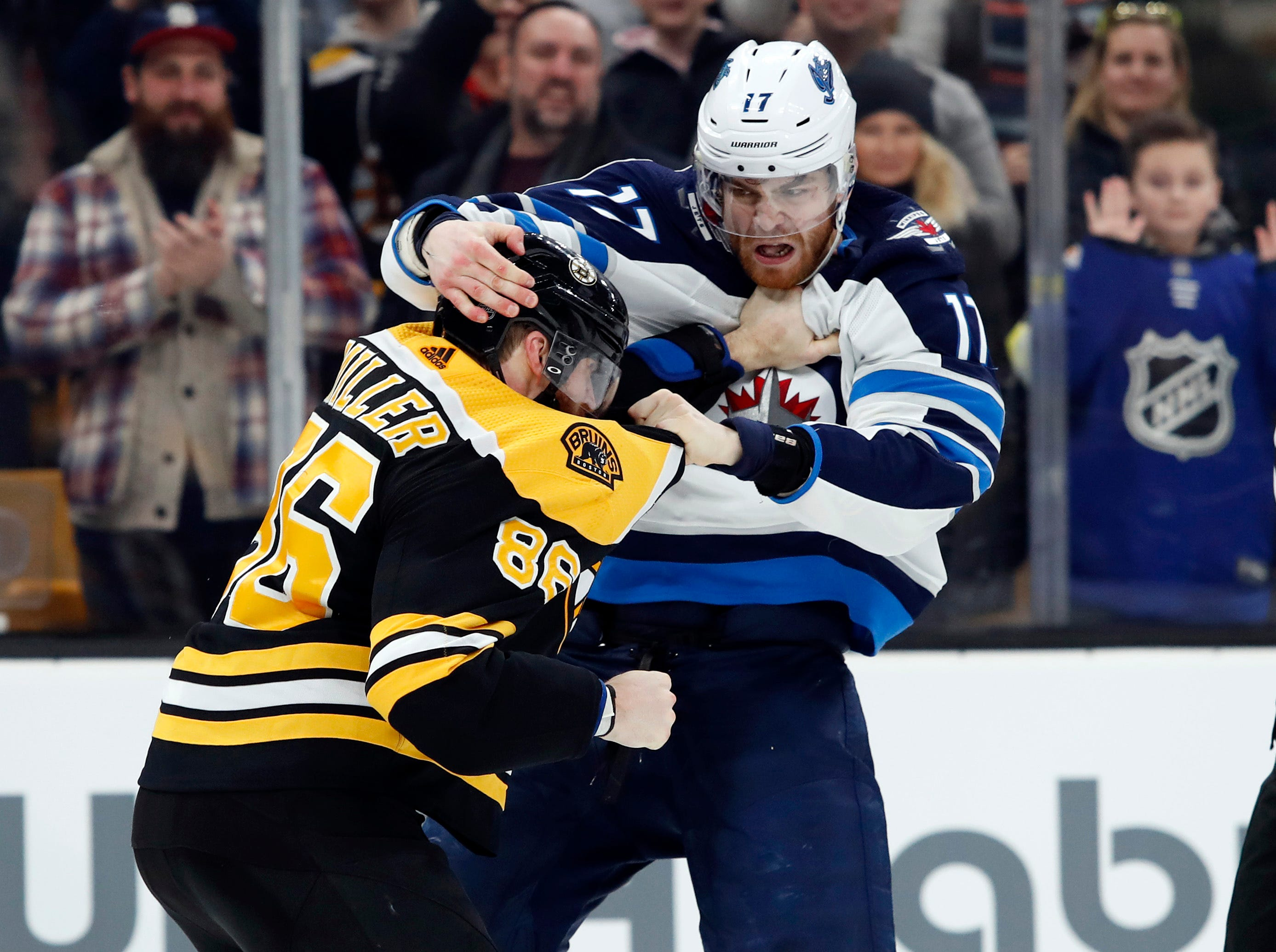 Jan. 29: Boston Bruins' Kevan Miller vs. Winnipeg Jets' Adam Lowry.