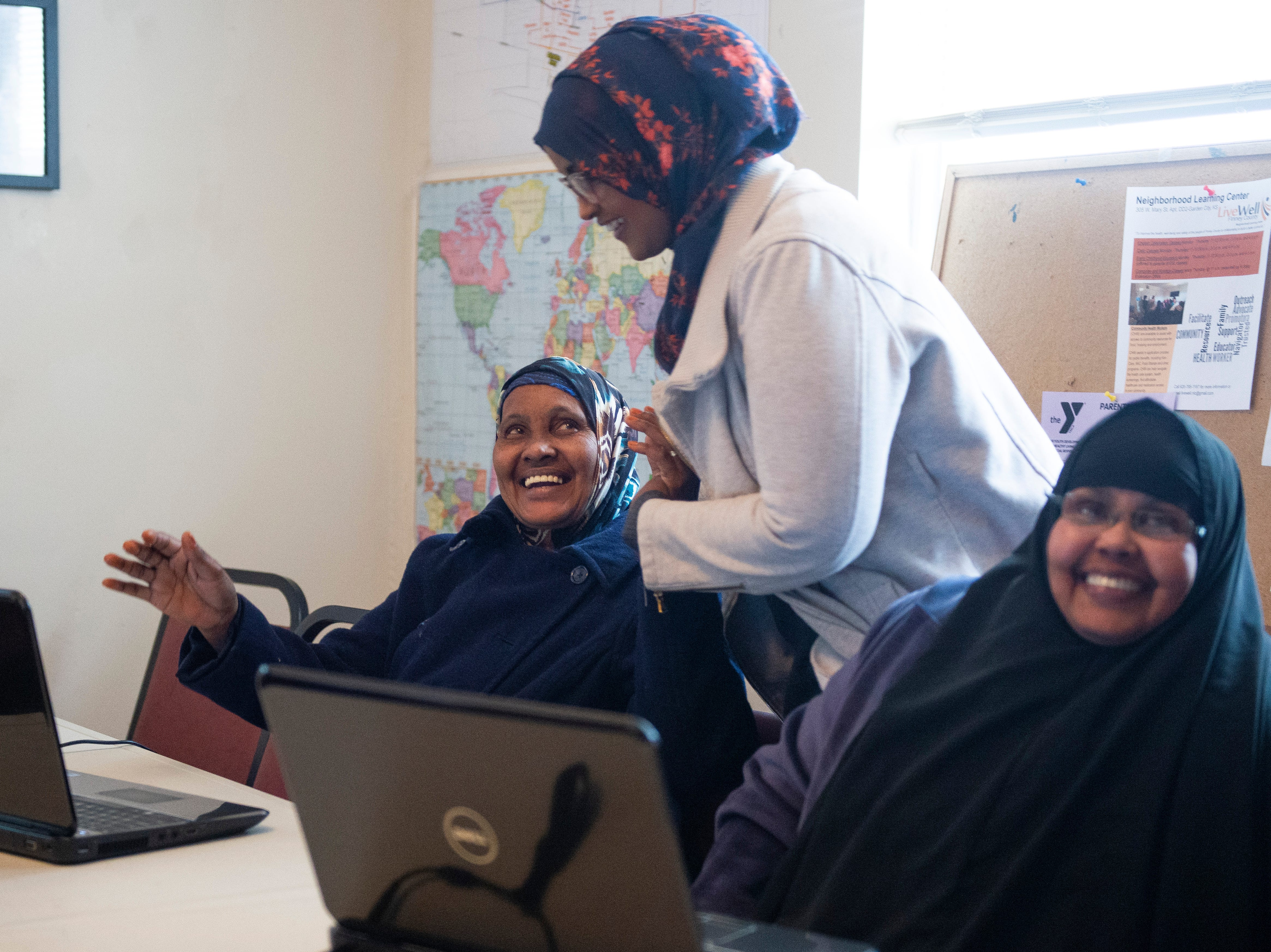 Asli Mohamud, left, smiles at Ifrah Ahmed while taking a nutrition class at LiveWell Neighborhood Learning Center Thursday, Jan. 24, 2019. The learning center helps refugees and immigrants learn English, learn to read and write and with other life skills.