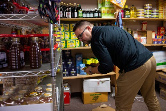 Kearny County Hospital CEO Benjamin Anderson shops at the African Shop, which stocks East African groceries and clothes.