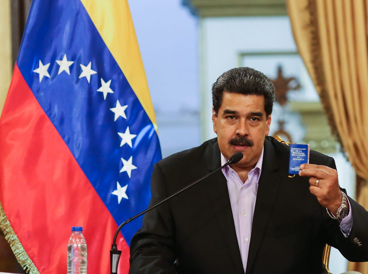 "Venezuelan President Nicolas Maduro talks during a meeting with Venezuelan diplomats returning from the US, at the Miraflores presidential palace in Caracas on Jan. 28, 2019.  On the 26th Maduro announced that the country began negotiations with the United States to open ""offices of interests"" to maintain a minimum level of relationship after breaking diplomatic ties."