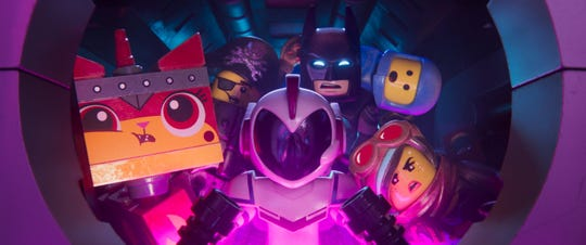 "General Mayhem (voiced by Stephanie Beatriz) takes Unikitty (Alison Brie), Metal Beard (Nick Offerman), Batman (Will Arnett), Benny (Charlie Day) and Lucy (Elizabeth Banks) in ""The Lego Movie 2: The Second Part."""