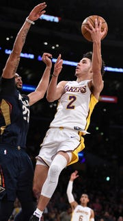 Lonzo Ball tries to score over forward Anthony Davis during a 2017 game.
