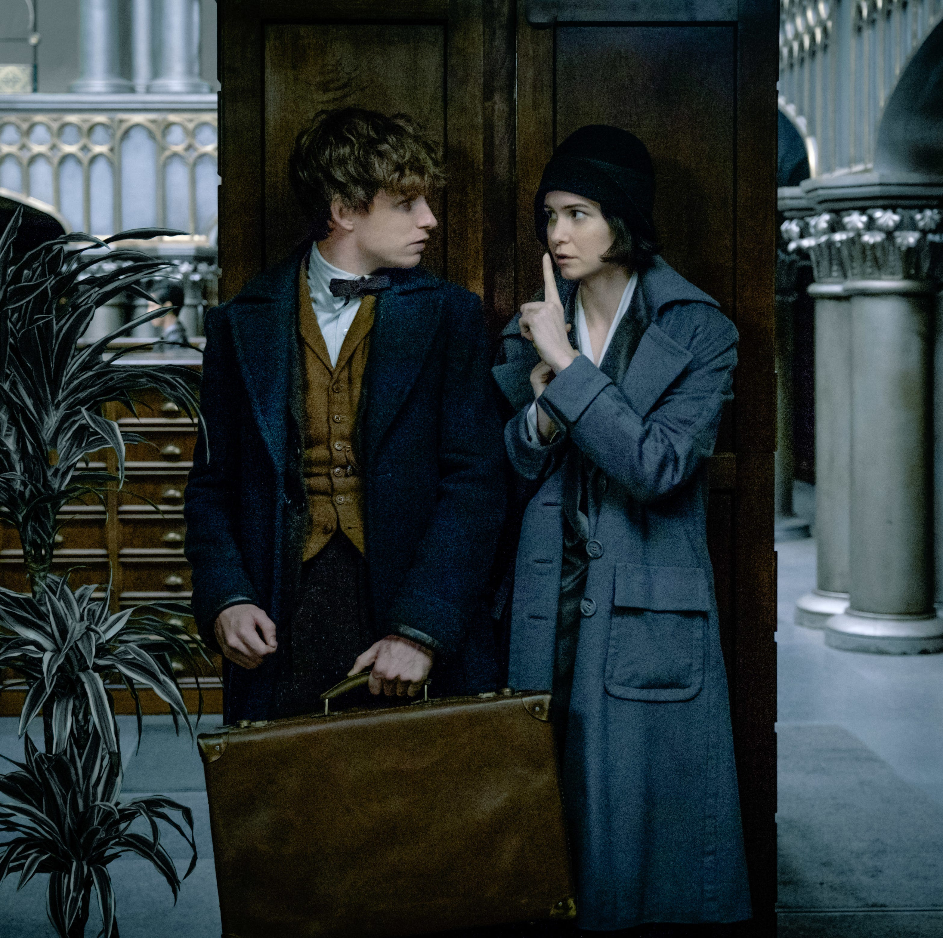 """Newt (Eddie Redmayne) and Tina (Katherine Waterston) are fugitives on a mission in """"Fantastic Beasts and Where to Find Them."""""""