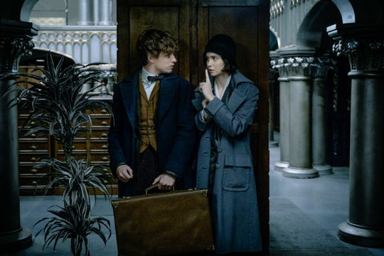 "Newt (Eddie Redmayne) and Tina (Katherine Waterston) are fugitives on a mission in ""Fantastic Beasts and Where to Find Them."""