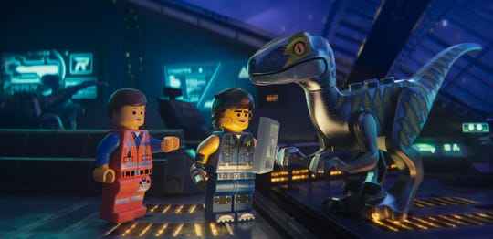 "Emmet (voiced by Chris Pratt) meets Rex Dangervest (also Pratt) and his raptor crew in ""The Lego Movie 2: The Second Part."""