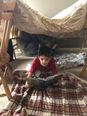 Jackson Gentry, 5, is a student in Jenny Puntenney's third-grade class. He is pictured reading in a homemade fort on Wednesday, January 30, 2019.
