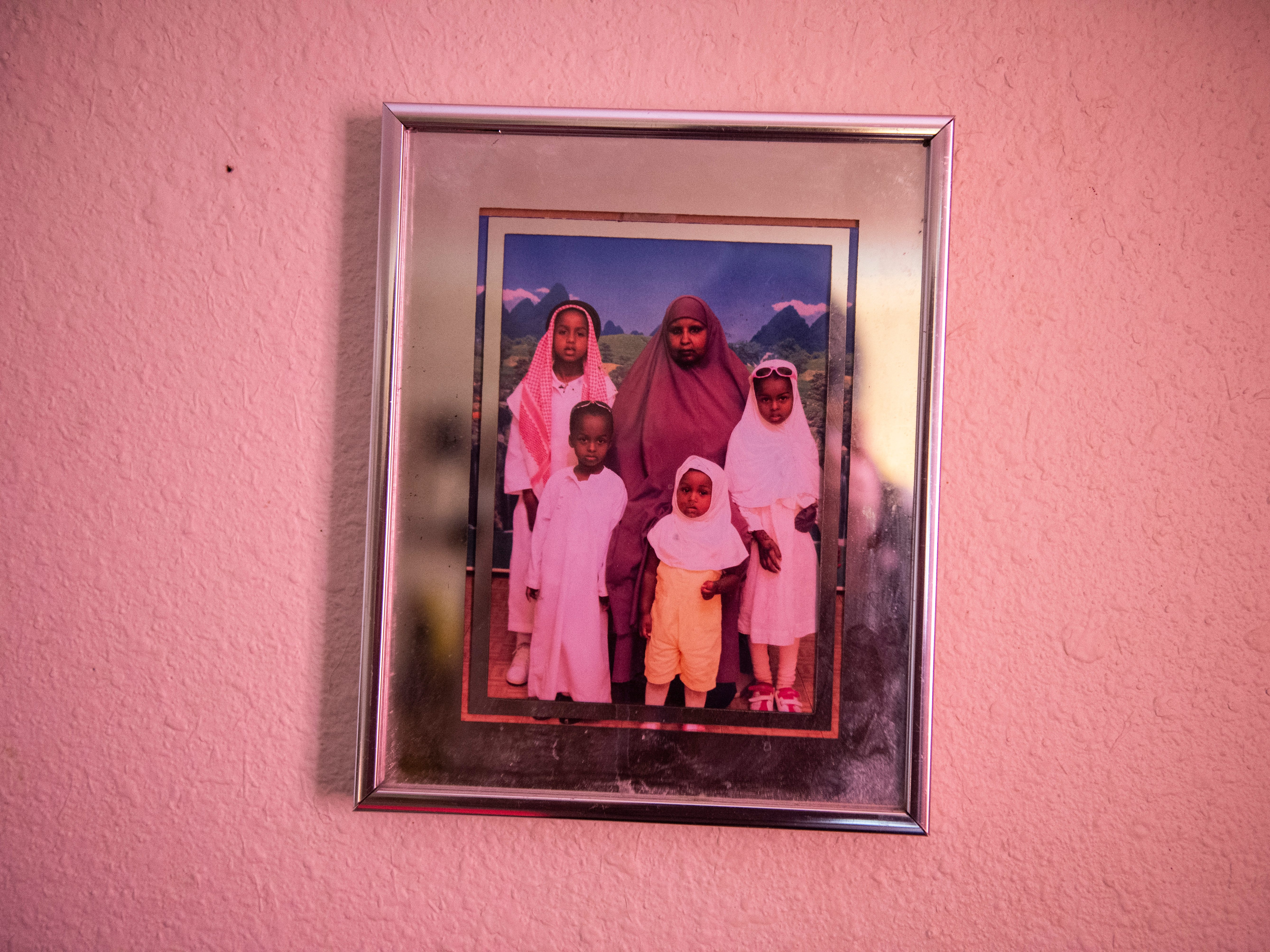 A photo of Ifrah Ahmed and her family hangs on the wall in her Garden City apartment.