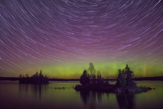 The northern lights splash the sky over Lake Superior in Minnesota.