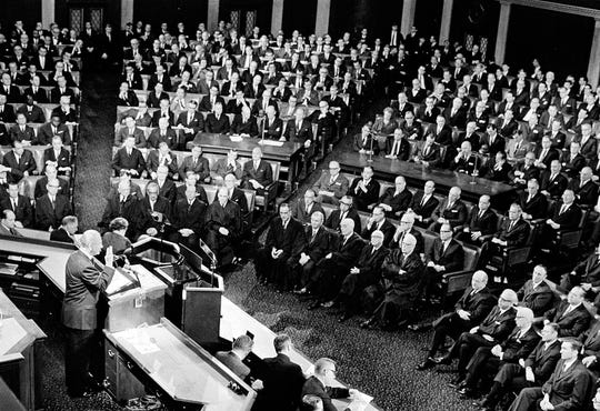 President Lyndon B. Johnson faces a joint session of Congress night of Jan.17,1968, as he delivers his State of the Union address. Seated in front row are members of the Supreme Court. (AP Photo) ORG XMIT: APHS203
