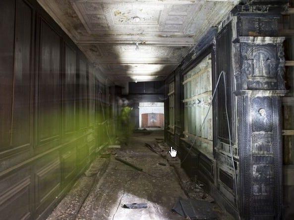 One of Hopwood Hall's many wood-paneled hallways, seen in 2011.