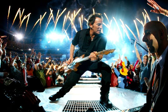 Bruce Springsteen and the E Street Band  perform at the Bridgestone halftime show during Super Bowl XLIII between the Arizona Cardinals and the Pittsburgh Steelers on February 1, 2009 at Raymond James Stadium in Tampa, Florida.