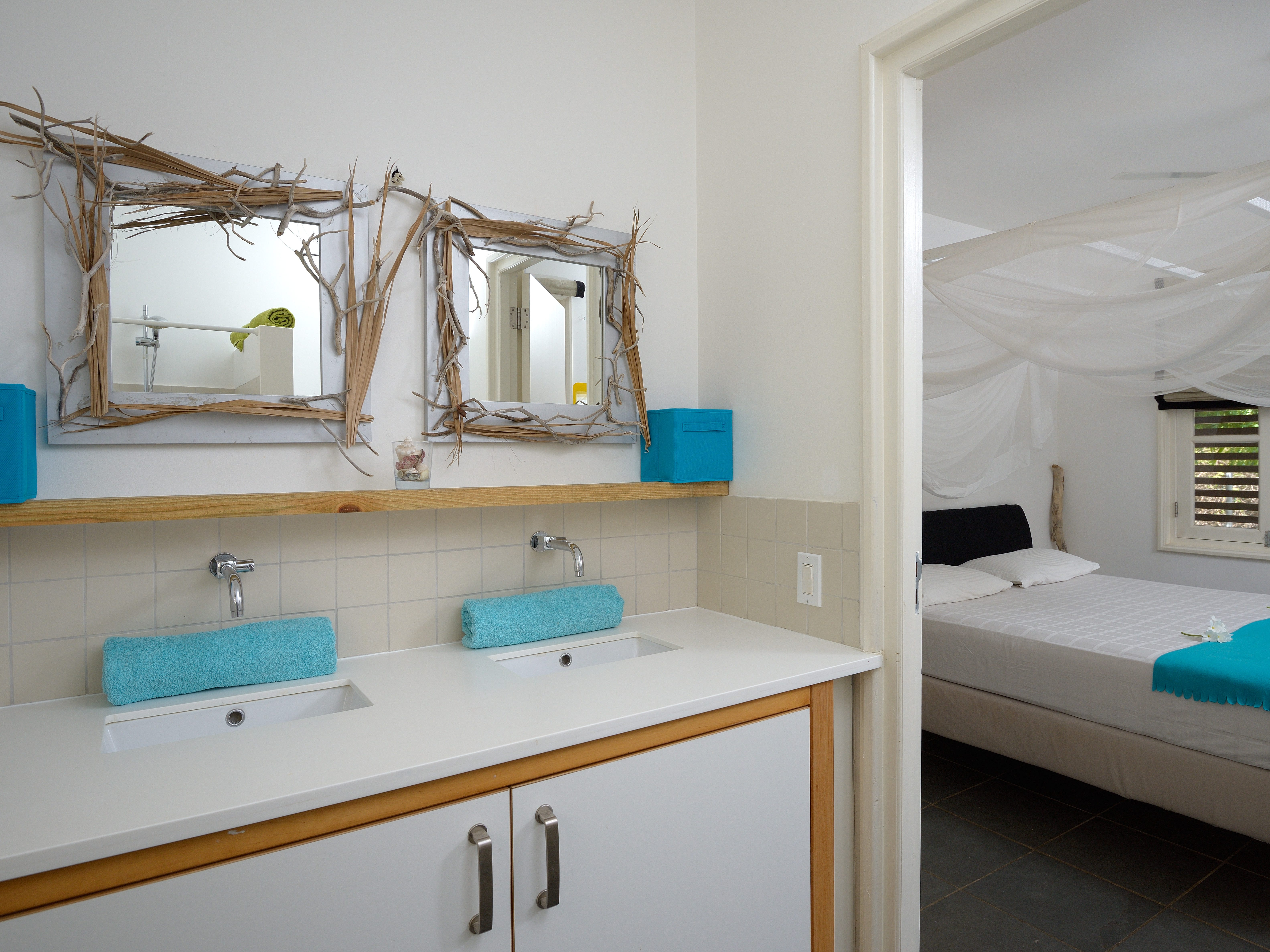 A bedroom and bathroom in the Bonaire bungalow