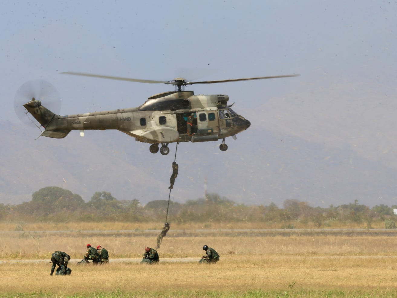 A French-made Super Cougar helicopter takes part in military exercises at the Libertador Air Base in Maracay, Aragua state, Venezuela, on Tuesday, Jan. 29, 2019.