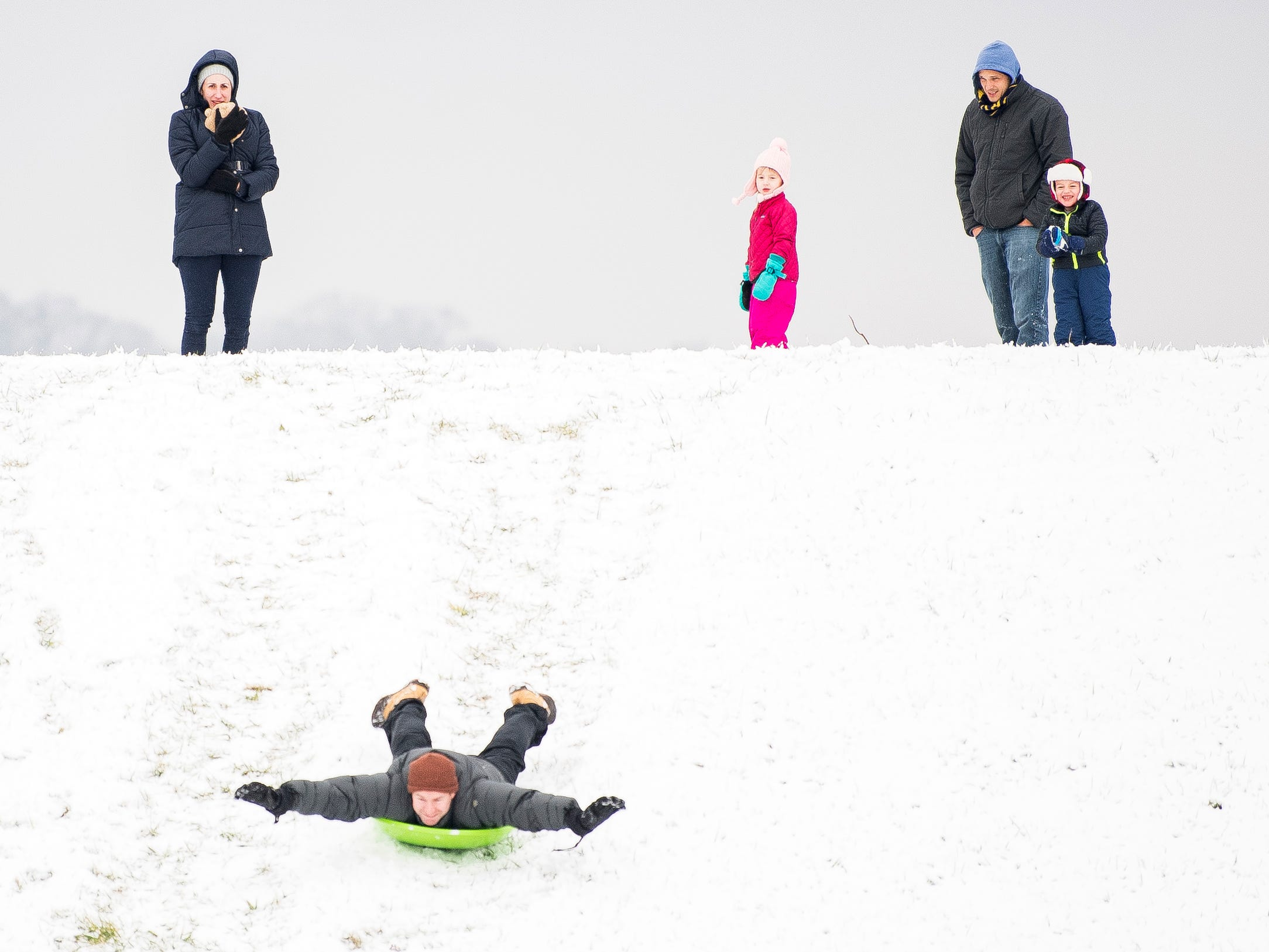 Families sled at Lakeshore Park in Knoxville, Jan. 29, 2019.