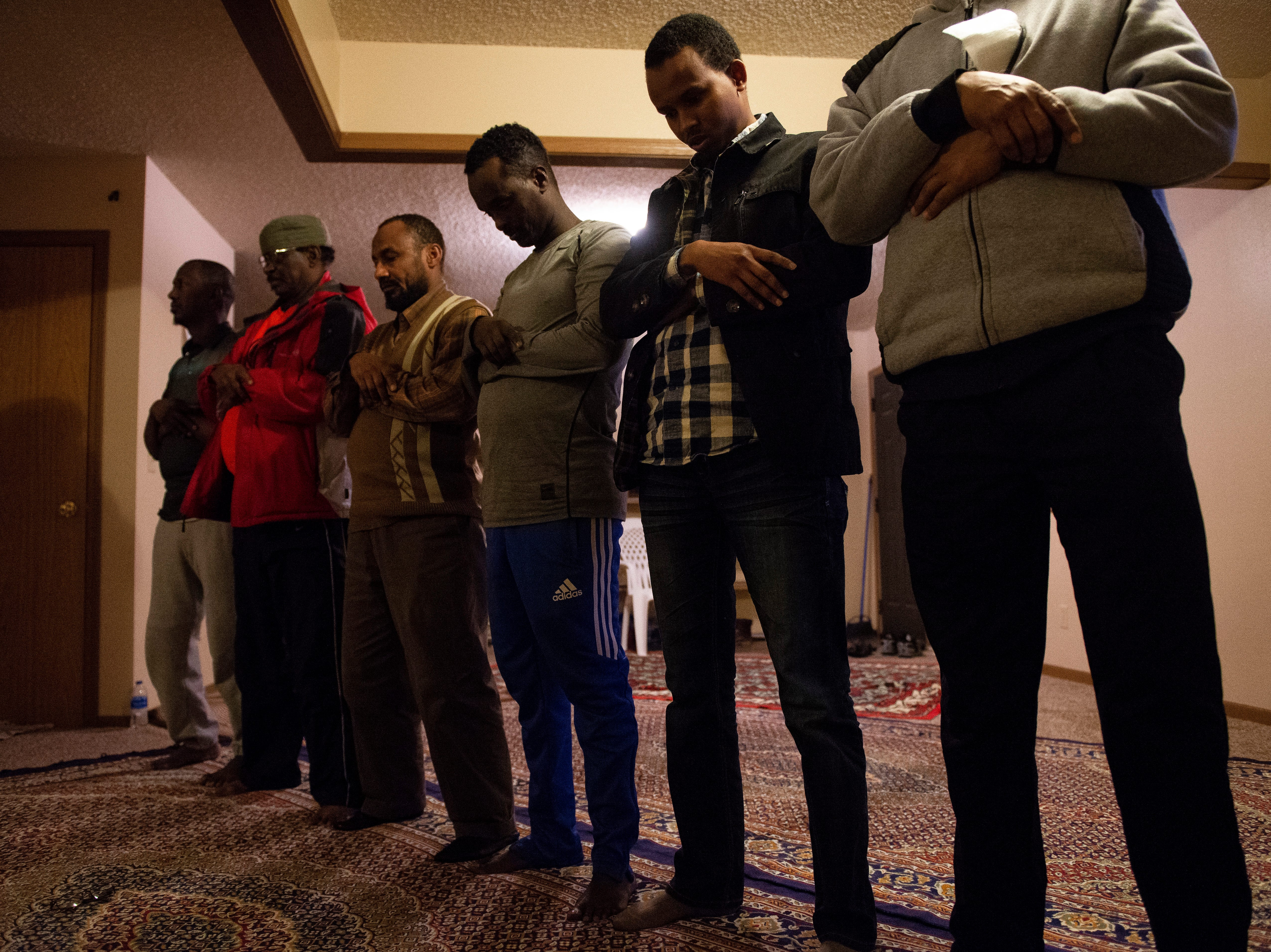 Somali refugees pray in an apartment that has been turned into a mosque at the Garden Spot Apartments on Wednesday, Jan. 23, 2019.