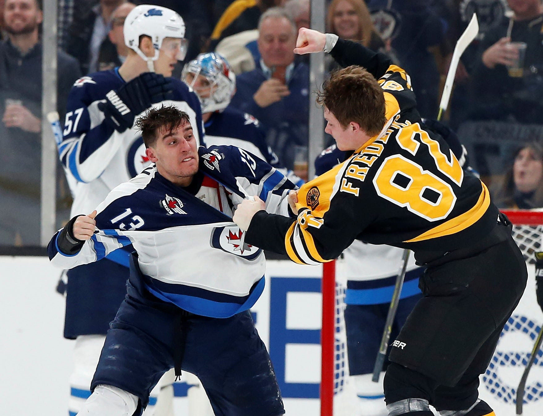 Bruins rookie Trent Frederic handily wins fight in NHL debut, and his parents are thrilled
