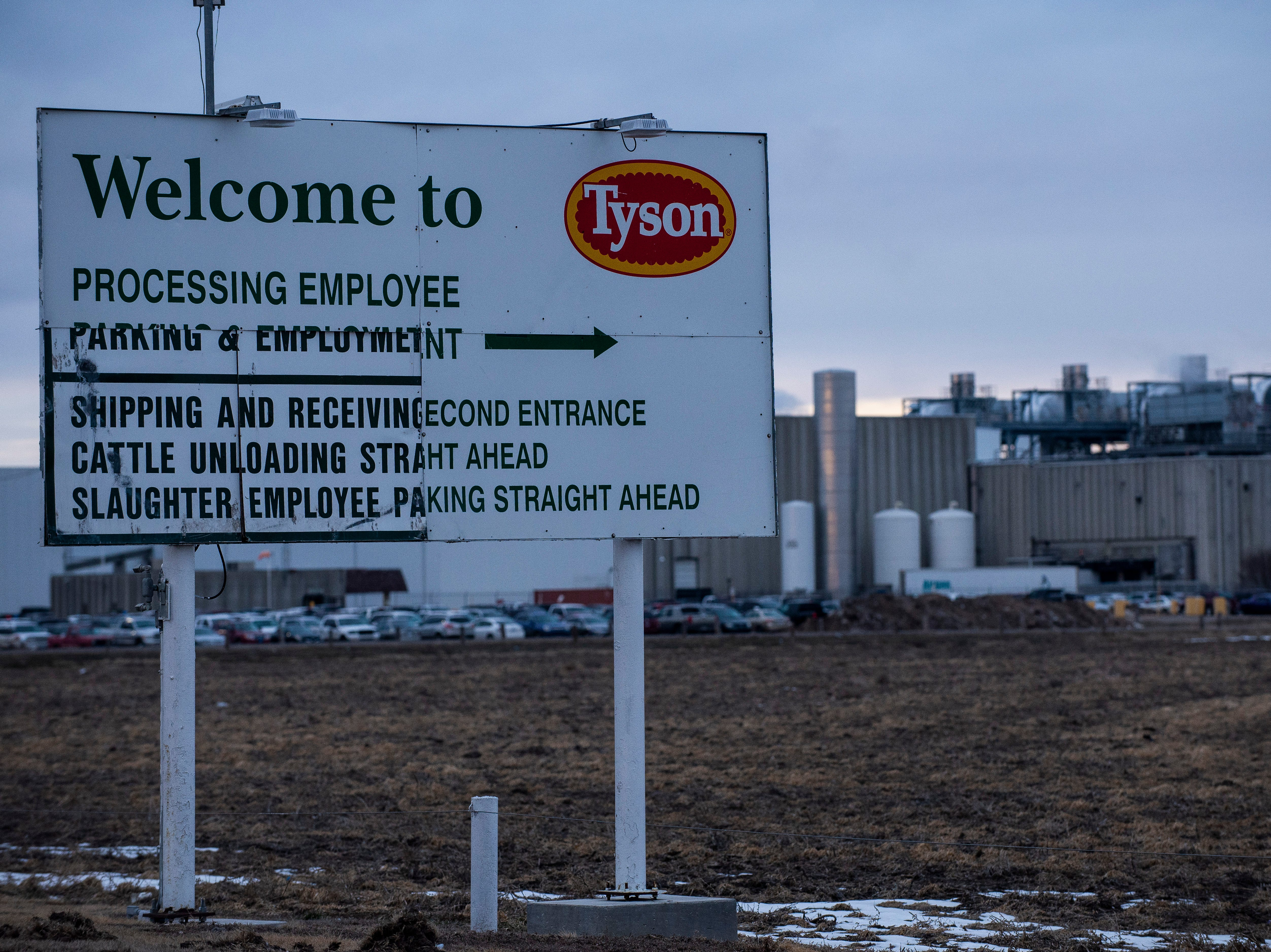 A sign welcomes people to the Tyson Fresh Meats meatpacking plant in Holcomb, Ks on Thursday, Jan. 24, 2019, where many of the refugees living in nearby Garden City work.