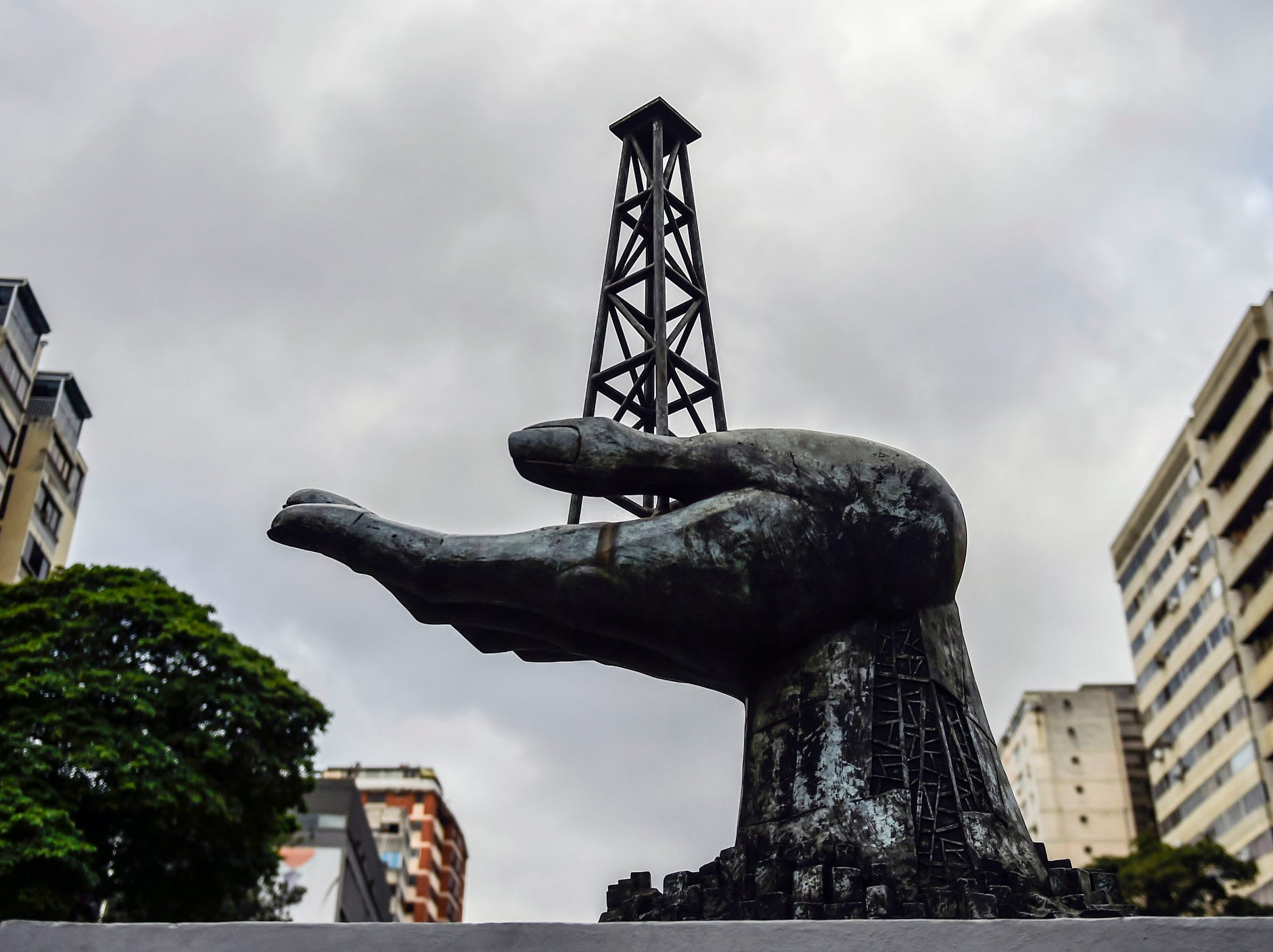 A monument to the struggles of the Venezuelan people for the conquest of their oil heritage is seen in front of the headquarters of Venezuelan state-owned oil company PDVSA in Caracas. The United States announced sanctions against Venezuela's state oil company Monday in a coordinated effort with the main opposition leader to cripple embattled President Nicolas Maduro's power base.
