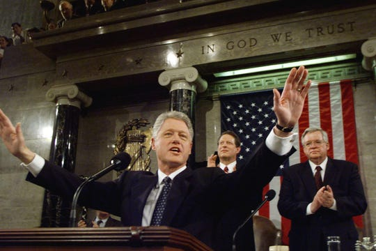 US President Bill Clinton accepts the applause of members of Congress late 19 January on his arrival at the podium for his State of the Union address on Capitol Hill in Washington, DC.  At left behind the president is US Vice President Al Gore and US Speaker of the House Dennis Hastert, R-IL.                 (ELECTRONIC IMAGE)    AFP  PHOTO   Win MacNamee ORG XMIT: DCA95