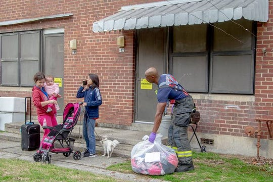 A Columbia Fire Department firefighter helps Tammy Basinger and her children, Matthew Rivera, 11, and daughter, Angel, 1, evacuate from their apartment at Allen Benedict Court after a gas leaked was discovered Friday, Jan. 18, 2019, in Columbia, SC. Columbia Fire Department officials evacuated hundreds of residents.