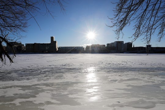 The sun rises over the Fox River on Thursday in Green Bay.