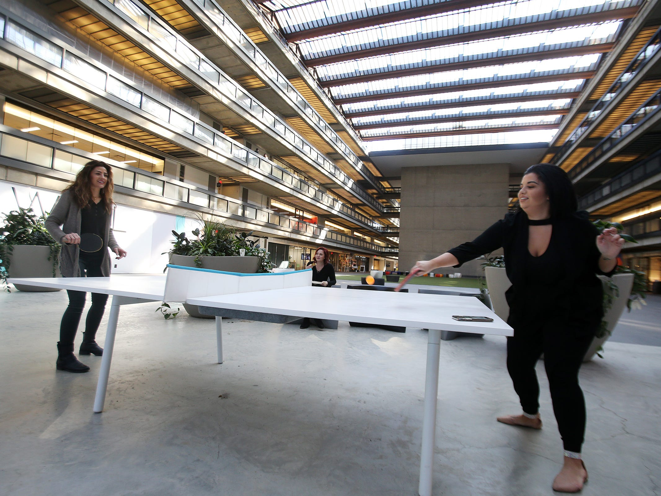 Nancy Araujo of East Brunswick and Daniella Tallarico of Brick, both work at Salon Concrete, play ping pong together at Bell Works in Holmdel, NJ Thursday January 31, 2019. Bell Works versus Fort Monmouth. Who's winning? The Shore's two biggest redevelopment projects got underway at about the same time, but Bell Works has pulled far ahead in the race.