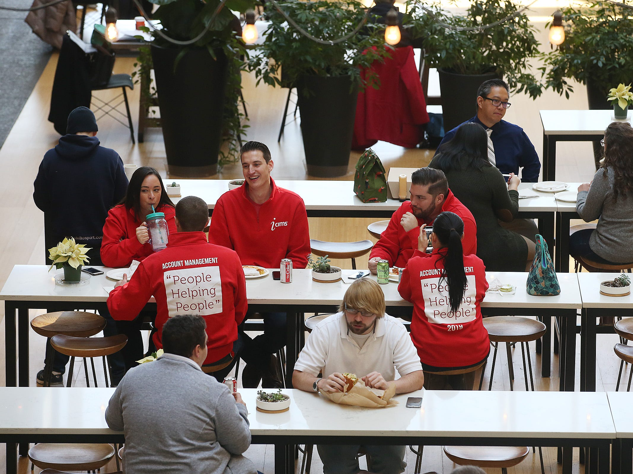 Employees of iCMS eat lunch together at Bell Works in Holmdel, NJ Thursday January 31, 2019. Bell Works versus Fort Monmouth. Who's winning? The Shore's two biggest redevelopment projects got underway at about the same time, but Bell Works has pulled far ahead in the race.