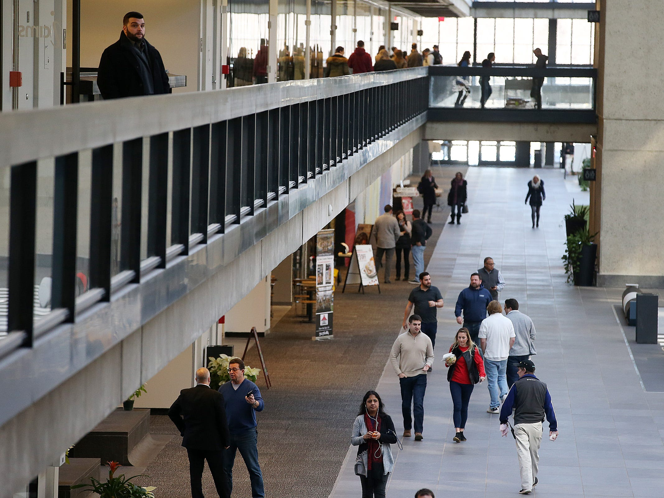 Employees and visitors walk the hallways and eat lunch in the open common space at Bell Works in Holmdel, NJ Thursday January 31, 2019. Bell Works versus Fort Monmouth. Who's winning? The Shore's two biggest redevelopment projects got underway at about the same time, but Bell Works has pulled far ahead in the race.