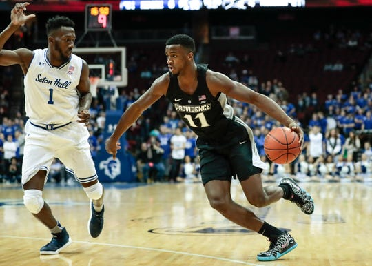 Providence Friars guard Alpha Diallo (11) dribbles the ball as as Seton Hall Pirates forward Michael Nzei (1) defends during the first half