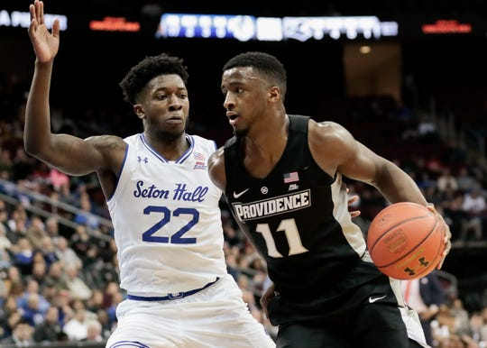 Providence Friars guard Alpha Diallo (11) dribbles as Seton Hall Pirates guard Myles Cale (22) defends during the first half at Prudential Center.