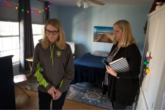 Megan Franzoso walks with her mother Debbie at the family's Toms River home.
