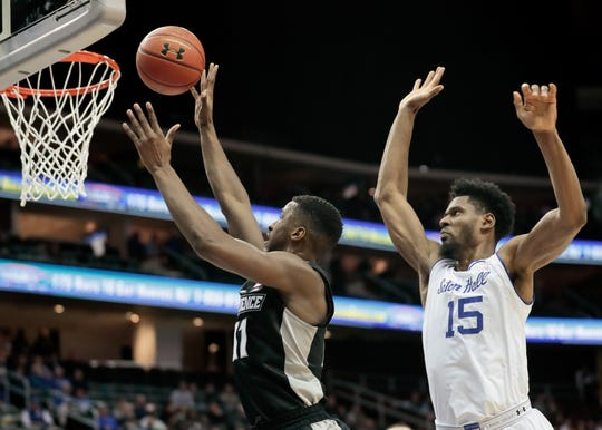 Providence Friars guard Alpha Diallo (11) shoots the ball as Seton Hall Pirates forward Taurean Thompson (15) defends