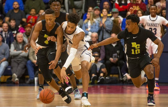 Ranney's Phillp Wheeler and Rosselle Park's Josh Pierre Louis battle for a loose ball. Ranney School Boys Basketball vs Roselle Catholic in the Jersey Shore Challenge at Brookdale College in Middletown, NJ on January 30, 2019.