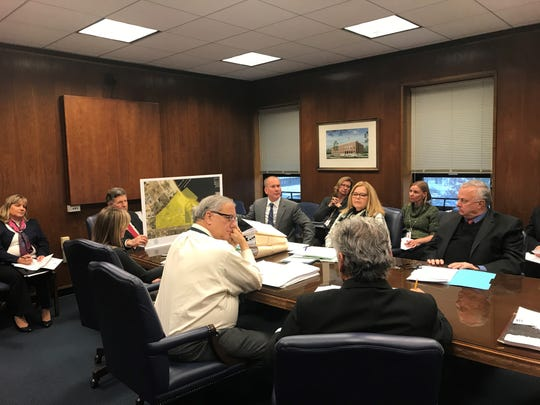 Ocean County administrative staff brief freeholders Wednesday on the details of a proposal to purchase 4.7 acres of riverfront property in Ocean Gate for conservation.