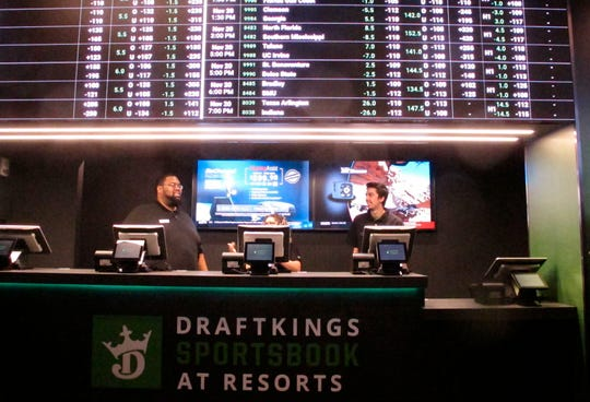 This Nov. 20, 2018 shows employees at the newly opened sportsbook at Resorts Casino in Atlantic City. On Thursday, Resorts launched an online sportsbook, two days after the Hard Rock casino began offering sports betting as well.