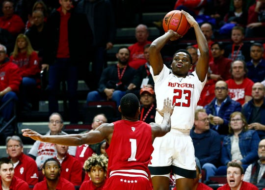 Jan 30, 2019; Piscataway, NJ, USA; Rutgers Scarlet Knights guard Montez Mathis (23) shoots over Indiana Hoosiers guard Aljami Durham (1) during the first half at Rutgers Athletic Center (RAC). Mandatory Credit: Noah K. Murray-USA TODAY Sports
