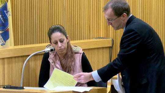 Monmouth County Assistant Prosecutor Matthew Bogner goes over plea agreement paperwork with Elizabeth Pinto during the trial of Jerry H. Spaulding, Ebenezer Byrd and Gregory Jean-Baptiste for the 2009 Neptune City murder of Jonelle Melton, a Red Bank school teacher in State Superior Court in Freehold Wednesday, January 30, 2019.  She was the driver of the car that took the defendants to and from the murder scene.