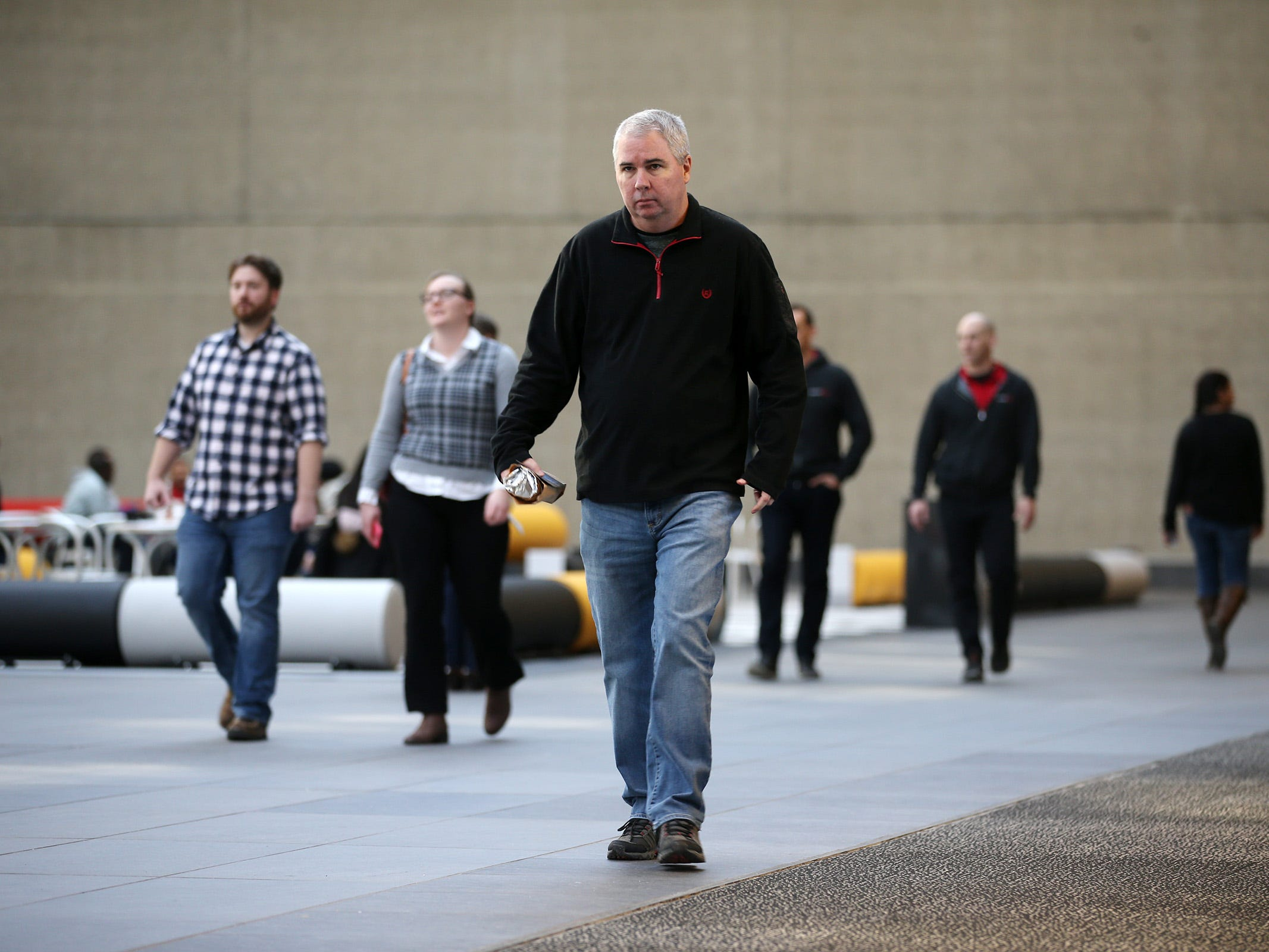 Vistors and employees walk around the building at Bell Works in Holmdel, NJ Thursday January 31, 2019. Bell Works versus Fort Monmouth. Who's winning? The Shore's two biggest redevelopment projects got underway at about the same time, but Bell Works has pulled far ahead in the race.