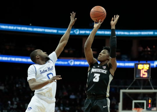 Providence Friars guard David Duke (3) shoots the ball as Seton Hall Pirates guard Quincy McKnight (0) defends during the first half at Prudential Center.