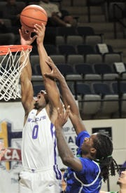 ACU's Jaylen Franklin (0) is fouled while trying to dunk the ball in the first half. The Wildcats beat Texas A&M-Corpus Christi 78-71 in the Southland Conference game Wednesday, Jan. 30, 2019, at Moody Coliseum.