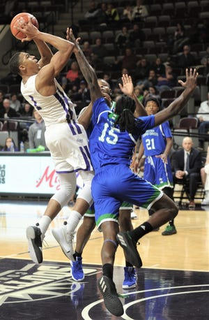 ACU's Jaren Lewis, left, is fouled by Texas A&M-Corpus Christi's Irshaad Hunte. Lewis hit the basket, but missed the free throw, giving the Wildcats a 74-71 lead with 30 seconds left in the game. ACU hung on to win the Southland Conference game 78-71 on Wednesday, Jan. 30, 2019, at Moody Coliseum.