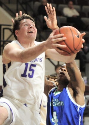 ACU's Hayden Farquhar (15) drives to the basket along the baseline as a Texas A&M-Corpus Christi's Jashawn Talton defends. Farqhuar was fouled on the play and hit two free frees to give the Wildcats a 67-66 lead with 4:27 left in the game. ACU won the Southland Conference game 78-71 on Wednesday, Jan. 30, 2019, at Moody Coliseum.