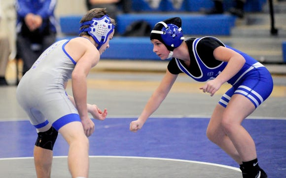 Polk County freshman Tori Strickland wrestlers against her male counterpart during a meet this season.