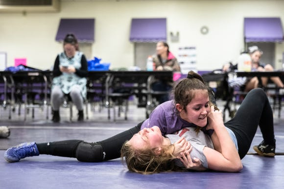 Glennin Hansen wrestles Abigail Fincher, both members of Relentless Wrestling, the first and only all-women's wrestling club in North Carolina, at Apple Valley Middle School in Hendersonville, Jan. 31, 2019.