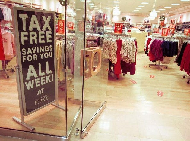 A sign promoting tax free shopping sits in The Children's Place in the oakdale Mall in January of 1999.