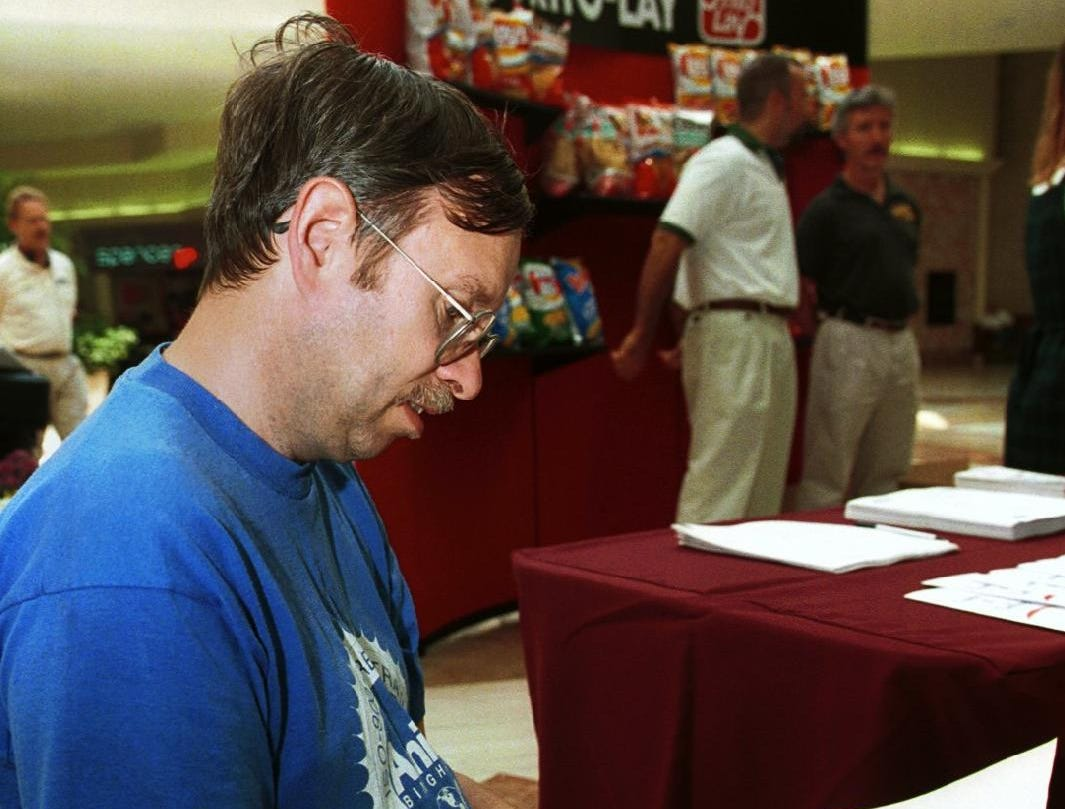 Larry LaBelle of Conklin fills out an application for Frito-Lay at a job fair at the Oakdale Mall in September of 1999.